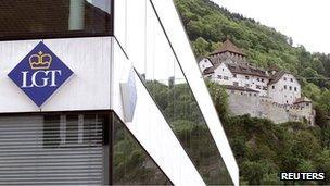 The logo of LGT Group is seen in front of the princely castle in Liechtenstein's capital, Vaduz