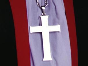 Church of England cross and garments