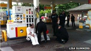 A man dressed as a polar bear chained himself to a pump
