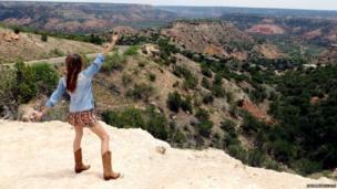Woman on cliff edge