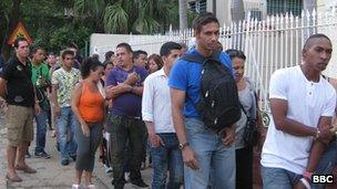 People queuing at an emigration office in Havana
