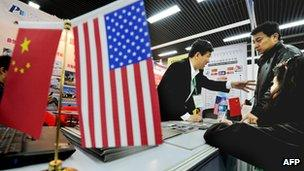 Potential Chinese real estate investors look at a display of United States property for sale at the Overseas and China Property Expo in Beijing, 5 April 2012