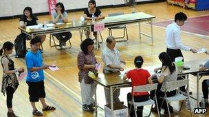 Local residents line up to vote at a polling station in Matsu island on 7 July, 2012 to open the first casino in Taiwan