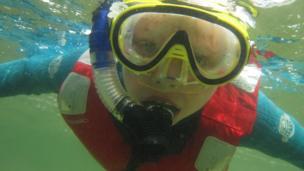 Boy snorkelling
