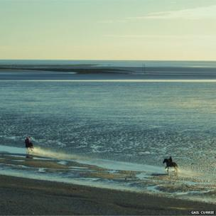 An early morning gallop on Morecambe beach