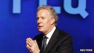 Quebec's premier Jean Charest speaks at a rally in his riding of Sherbrooke, Quebec, 31 July 2012