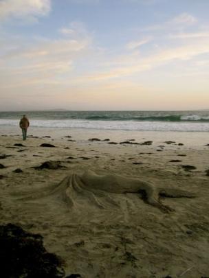 Mermaid sand sculpture on the beach