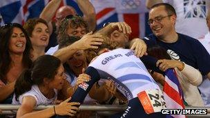 Laura Trott hugs her family