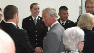 Prince Charles speaking to rescuers and flood victims