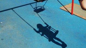 Shadow of child on swing