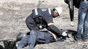Injured policeman is treated after riot at Lonmin mine. 13 Aug 2012