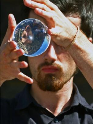 Man holding a looking glass