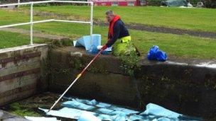 Staff from the Environment Agency used absorbent booms and pads to soak up the oil spill