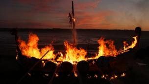 Replica Viking longboat engulfed in flames