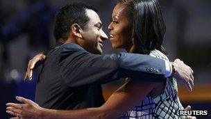 Indian-American actor Kal Penn hugs Michelle Obama at the 2012 Democratic Convention