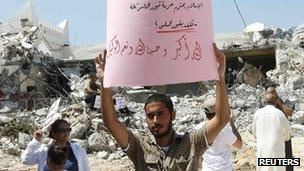 Protesters take part in a demonstration against the demolition of a Sufi mosque by ultra-conservative Salafis in Tripoli August 26, 2012.