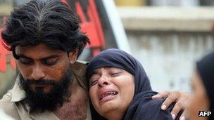Relatives outside garment factory following a fire in Karachi, on September 12, 2012.