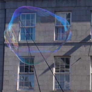 Giant bubble in front of a building