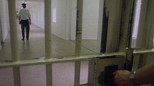 A prison door being locked