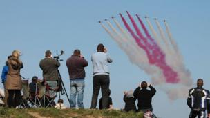 Photographers take photos of the Red Arrows