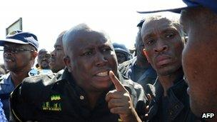 Julius Malema surrounded by police officers on 17 September 2012