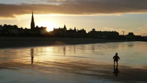 "Lee Kindness took this shot of his ""photographic assistant"" taking a walk along the beach at Portobello before bed."