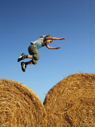 Ethan jumping on hay bales