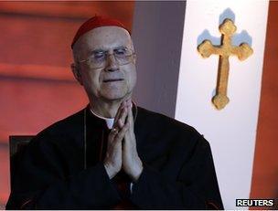 Vatican State Secretary Cardinal Tarcisio Bertone prays as Pope Benedict XVI meets youths in Harissa, near Beirut, 15 September