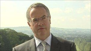Alex Attwood is managing the changes to local councils