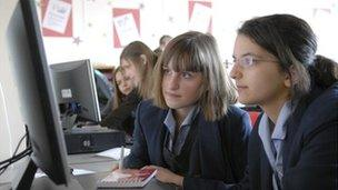 Schoolgirls with computer