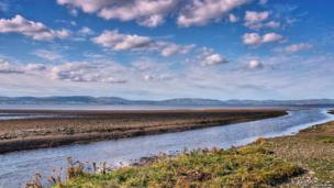 Clouds under a cold blue sky over Lough Foyle