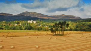 Ollie Hughes shot this image of a field with hay bales, with Atholl Palace Spa hotel in Pitlochry in the background