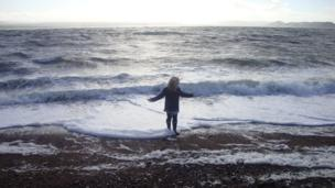 Holly Paterson from Inverness enjoys the waves on a windy autumn day at Channory Point in Fortrose. Image taken by Holly's grandfather, Alister Paterson.