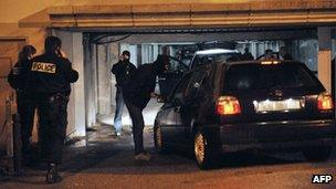 French police take part in a search in the Paris suburb of Torcy, 9 October 2012