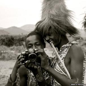 Men look at photos on a camera