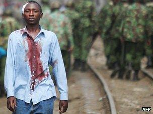 Injured man in Kibera slum, Nairobi, in January 2008