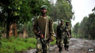 M23 rebel soldiers patrol near Rutshuru, 17 October 2012