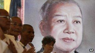 Cambodian Buddhist nuns in front of a picture of Norodom Sihanouk