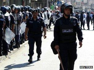 Riot police at a protest in Amman (5 October 2012)