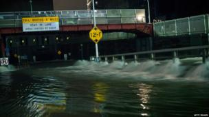 Flood water rushes into the entrance of the Carey tunnel, New York.