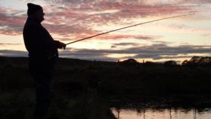 Fisherman at dusk