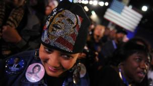Supporters of US President Barack Obama celebrate as she watches voting results on election night on November 6, 2012 in Chicago, Illinois