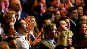 Romney supporters watch screens at the Boston Convention and Exhibition Center