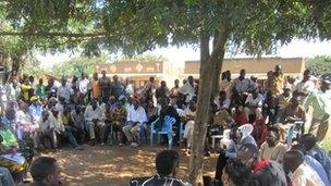 Kabaale village meeting about oil farm evictions