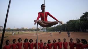Girl performing a mallakhamb pose