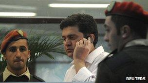 Former Georgian Interior Minister Bacho Akhalaia (C) speaks on his mobile inside the prosecutor's office in Tbilisi on 6 November