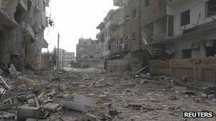 """A view of buildings damaged by what activists said were missiles fired by a Syrian Air Force fighter jet loyal to Syria""""s President Bashar al-Assad in Daria, near Damascus, 30 November 2012"""