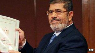 Mr Morsi receives a copy of the draft constitution, 1 Dec