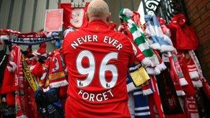 Liverpool supporter pays his respects at the Hillsborough Memorial at Anfield