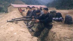 File photo of Maoist rebels in Nepal (2004)